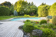 Leinwanddruck Bild - Garden and swimming pool in backyard