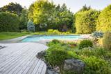 Garden and swimming pool in backyard - 73538734