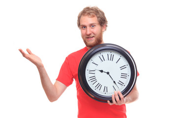 Bearded man holding big clock and pointing