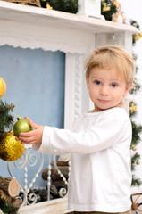 blond boy in christmas interior