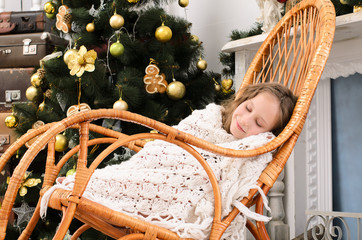 girl sleeping in rocking chair