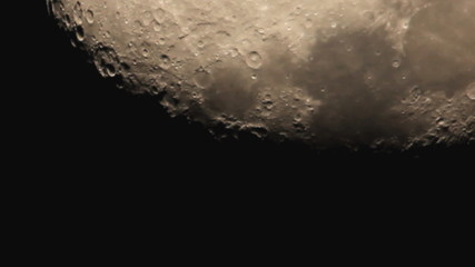 The moon with light clouds, close up view, strong zoom
