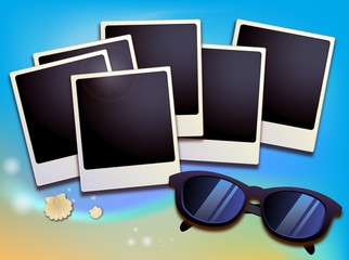 Summer like old style empty photo cards lying on a sea sand and