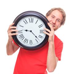 Happy man holding big clock on white