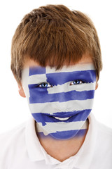 Young boy with Greeg flag painted on his face