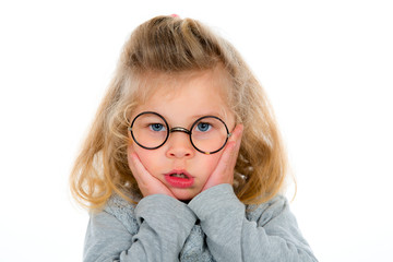 little girl with round  glasses is bored