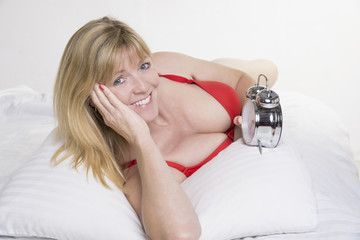 Woman checking her alarm clock