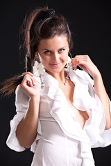 Beautiful young girl in white blouse