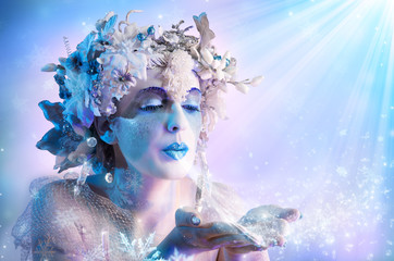 Winter portrait  blowing snowflakes