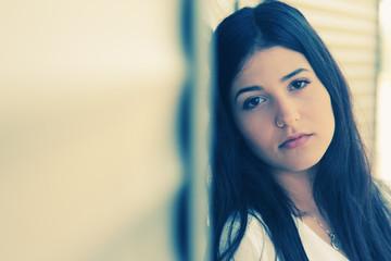 Closeup portrait of beautiful young girl