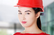Portrait of confident female worker in helmet.