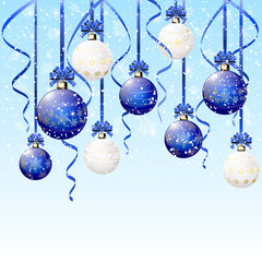 Blue and white Christmas balls on snowy background