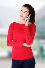 Young woman is calling with a mobile phone