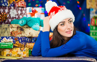 positive young brunet portrait at holiday background