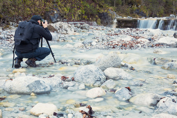 Photographer take a picture of a waterfall