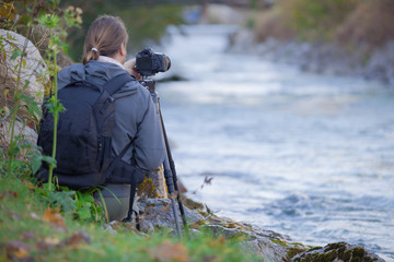 Photgrapher taking picture of  a  river