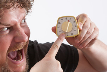 Man with Eggtimer in his hand is looking very angry