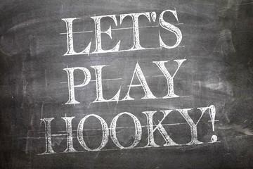 Lets Play Hooky written on blackboard