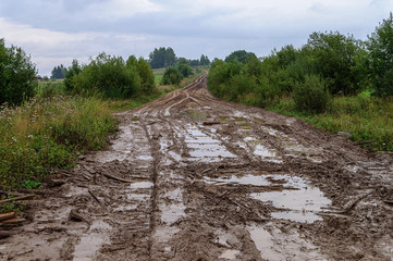 Muddy dirt road in a hilly countryside