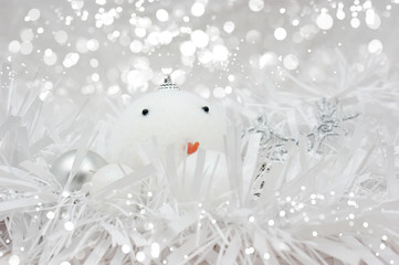Christmas snowman bauble in tinsel