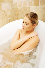 Portrait of a woman with closed eyes relaxing in bath