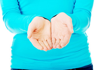 Close up on woman cupped hands