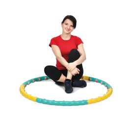 girl sitting with hula hoop