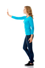 Side view woman touching imaginary screen