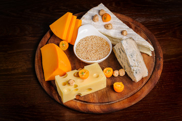 various cheeses with nuts and fruits