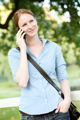 Woman Calling by Phone in a Park