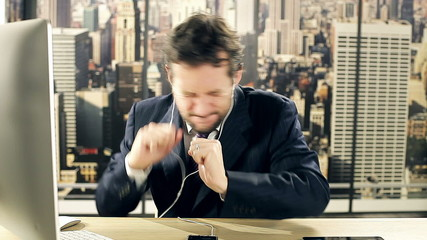 Business man dancing and singing listening music