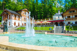 Park with historic buildings in Szczawnica town, Pieniny, Poland