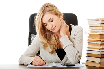 Woman preparing to exam, counting on calculator