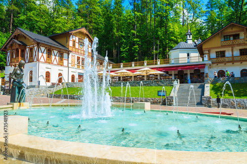 Park with historic buildings in Szczawnica town, Pieniny, Poland - 73548923