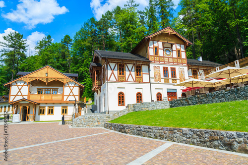 Park with historic buildings in Szczawnica town, Pieniny, Poland - 73548932