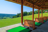 Golf course on sunny summer day in Arlamow village, Poland