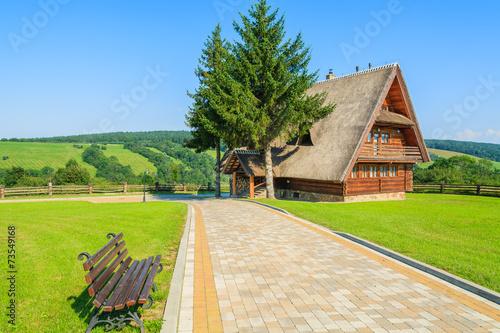 Walking alley to mountain house in Arlamow village, Poland