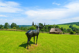 Deer statue on green field in Bieszczady Mountains, Poland - 73549370