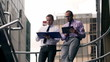 Businessmen consulting results on tablet and documents