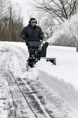 Man Clearing Driveway of Snow