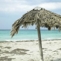 Parasol on an abandonned beach