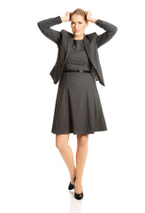 Angry businesswoman pulling her head