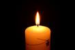 White christmas candle burning on a black background