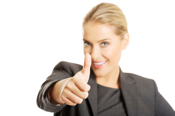 Businesswoman with thumbs up gesture