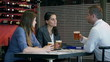 Businesspeople drinking beer in the restaurant and talking