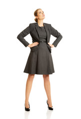 Businesswoman standing with her hands on hips