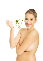 Healthy woman holding a fork with cuckooflower