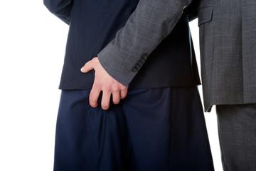 Businessman holding hand on partners ass