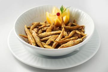 Smelt, capelin, small mackerel in corn batter with lemon