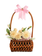 Gift basket of artificial flowers isolated on white background